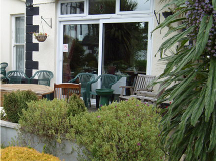 You can site outside on a sunny evening and enjoy the garden at Tudor court falmouth
